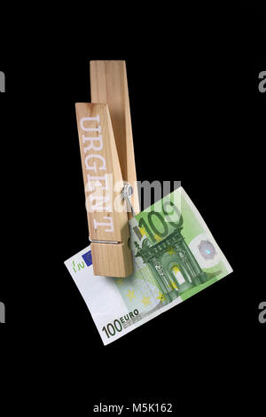 clothespin with one hundred euro bill, it is urgently needed money