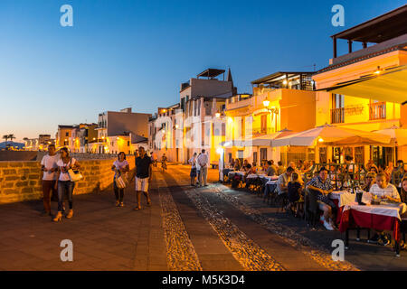 Waterfront in the coastal town of Alghero after sunset, Sardinia, Italy - Stock Photo