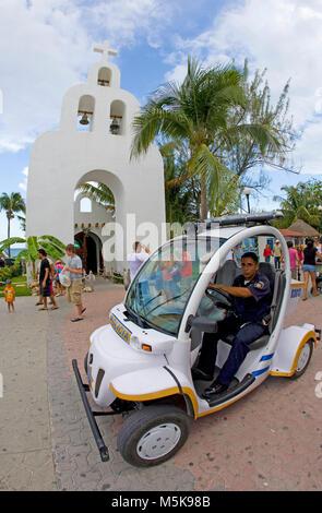Policeman with e-car at strolling promenade of Playa del Carmen, Mexico, Caribbean