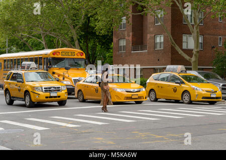 New York City, USA - June 08, 2015: New York yellow taxi cab stop at pedestrians traffic lights crossing the street - Stock Photo