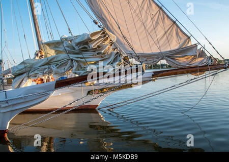Close up of on the bow of two traditional Skipjack boats resting on the calm waters of the Chesapeake Bay,  Deal - Stock Photo