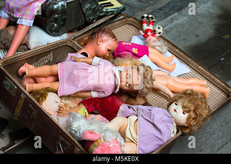 Old dolls. Old dolls in an old suitcase. Retro Dolls - Stock Photo