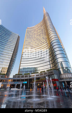 View of the Unicredit Tower spire from the Gae Aulenti square. Milan, Lombardy, Italy. - Stock Photo