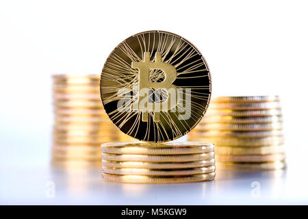 Piles of bitcoins with single coin standing on top, cryptocurrency concept, selective focus on one bitcoin - Stock Photo