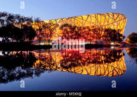 Beijing National Stadium / Beijing Birds Nest Olympic Stadium at night, Beijing, China - Stock Photo