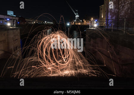 Fireball in the harbour. Steel wool. - Stock Photo
