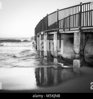 Black and White Photograph of the McGurk Beach Jetty at sunrise in Toes Beach, Playa Del Rey, CA. - Stock Photo