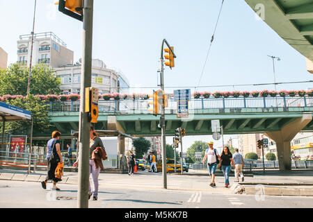 Istanbul, June 11, 2017: Editorial image of pedestrians crossing traffic light controlled street in Aksaray, Fatih - Stock Photo