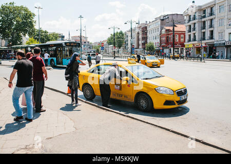 Istanbul, June 11, 2017: A traditional yellow taxi on the street in the Fatih district of Istanbul, Turkey. Customers - Stock Photo