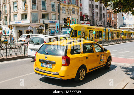 Istanbul, June 11, 2017: A traditional yellow taxi rides on the street in the Fatih district of Istanbul, Turkey. - Stock Photo