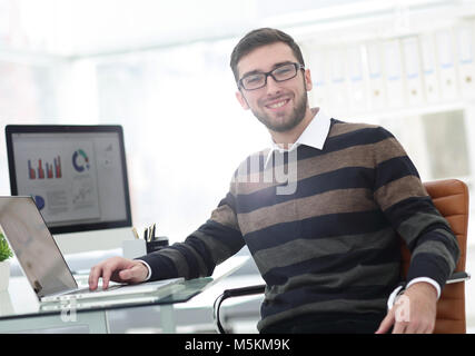 employee works with marketing schemes - Stock Photo