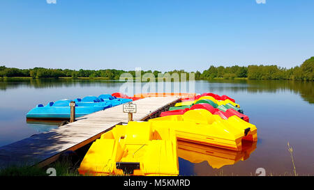 Colorful pedal boats on the boat dock at sea - Stock Photo