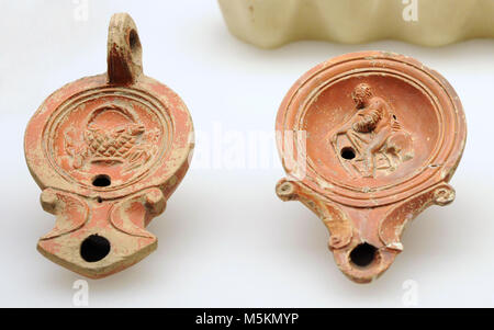 Roman oil lamps. Roman-Germanic Museum. Cologne. Germany. - Stock Photo