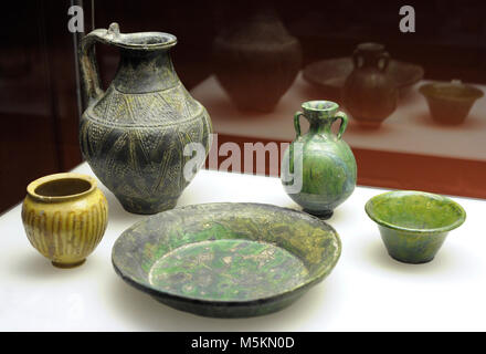 Set of Roman ceramic objects in green and yellow. From Cologne (Luxembourg and Aachener streets) and unknown origin. - Stock Photo