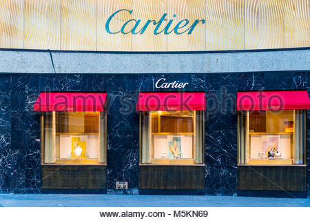 Expensive Cartier watches in shop window display London England UK