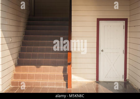 Architecture building interior design of staircase and white wooden door of room under stair. - Stock Photo