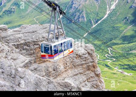 SASS PORDOI, ITALY JULY 18, 2014 - Cable car of Sass Pordoi mountain massif, Dolomites, Italy, Europe - Stock Photo