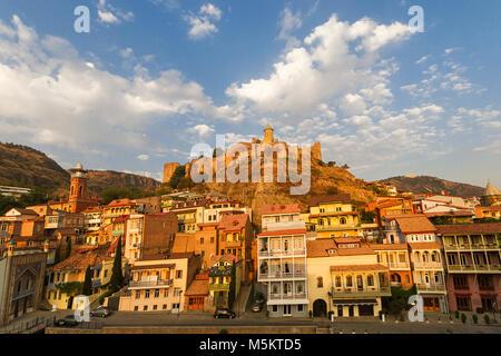 Colorful old houses and Narikala Castle in Tbilisi, Georgia. - Stock Photo