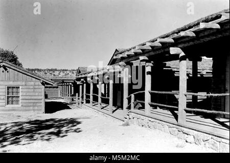 Bright Angel Lodge Exterior c  . WEST WING OF BRIGHT ANGEL LODGE. COVERED BOARDWALK FOR RIM CABINS. 1936. - Stock Photo