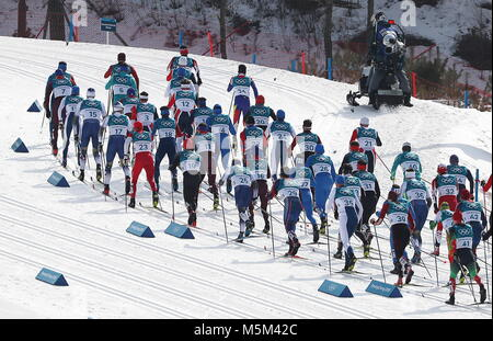 PYEONGCHANG, SOUTH KOREA - FEBRUARY 24, 2018: Skiers compete in the men's cross country skiing 50km mass start classic - Stock Photo