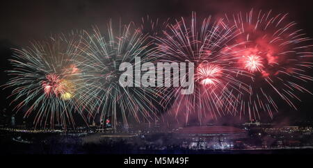 Moscow, Russia. 23rd Feb, 2018. MOSCOW, RUSSIA - FEBRUARY 23, 2018: Fireworks light up the sky over Luzhniki Stadium - Stock Photo