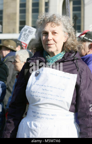 A women wearing a nurses apron with Nye Bevan quotes written on it, Bolton, 24th February, 2018 (C)Barbara Cook/Alamy - Stock Photo