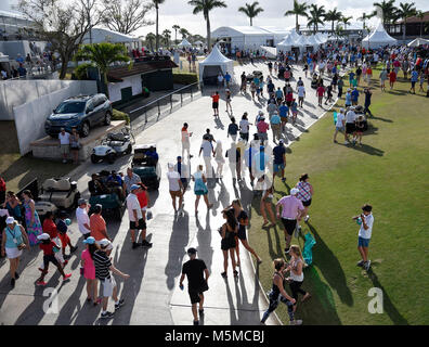 Palm Beach Gardens, Florida, USA. 24th Feb, 2018. Golf spectators cast long shadows at the end of the third round - Stock Photo