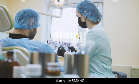Stomatology - doctor and patient in the dental office, examination the mouth - Stock Photo