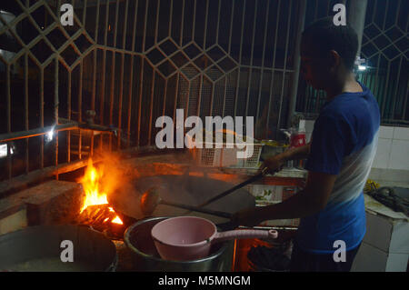 MAKASSAR, INDONESIA - JANUARY, 5, 2015 : mie titi, fried noodles mixed with sauce at Makassar Indonesia - Stock Photo