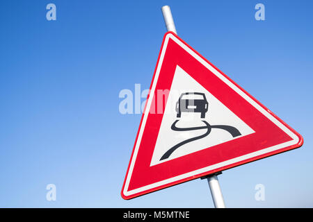 Dutch road sign: slippery road - Stock Photo