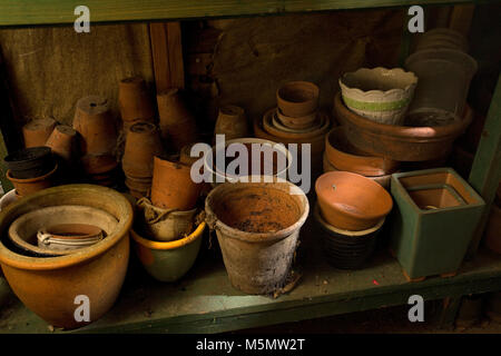 Terracotta pots in garden shed - Stock Photo