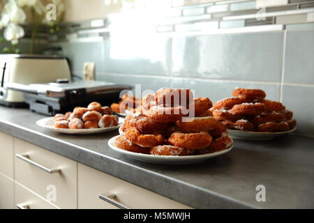 A homemade donut, despite the non-ideal shape, is a taste superior to any other donut purchased in a store or in - Stock Photo