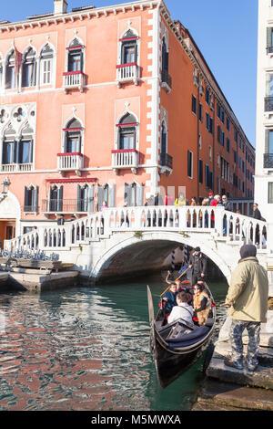 Gondola about to offload tourists in front of the Danieli Hotel, Riva degli Schiavoni, Castello, Venice, Italy with - Stock Photo