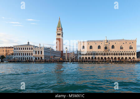 Doges Palace, St Marks Bell Tower  or Campanile and Clock Tower at sunset in soft warm light, San Marco Venice, - Stock Photo