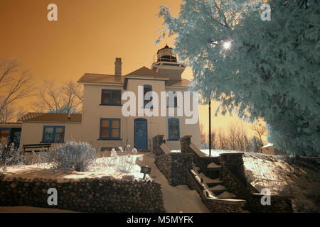 Exterior of historic Mission Point Lighthouse in winter in infrared. - Stock Photo