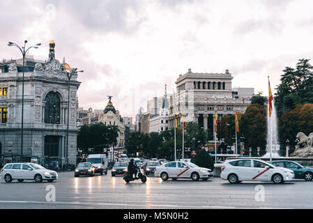 Madrid, Spain - November 3, 2017:  View of Cybele Square, Alcala Street and Bank of Spain building. The plaza is - Stock Photo