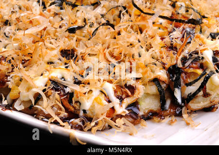 Japanese Okonomiyaki is japanese pizza great and yammy - Stock Photo
