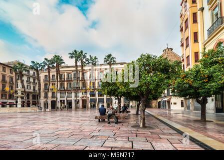 Malaga, Spain - December 7, 2016: People rest on the Constitution Square (Plaza de la Constitucion de Malaga) in - Stock Photo