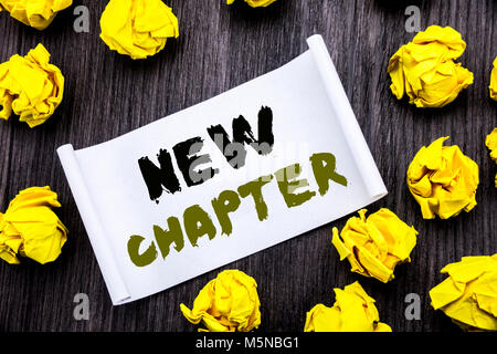 Writing text showing New Chapter. Business concept for Starting New Future Life Written on sticky note notepad notebook - Stock Photo