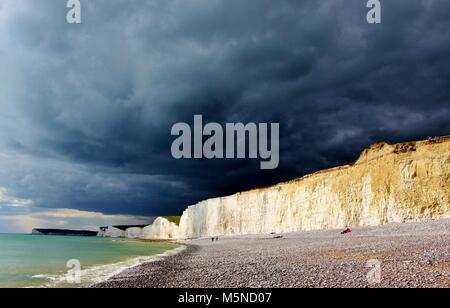 Dramatic stormy skies over the famous chalk cliffs at Birling Gap in the South Downs National Park - Stock Photo