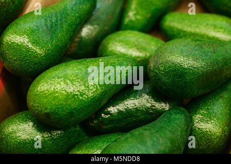 Green fresh delicious avocado. Healthy nutritious food. - Stock Photo