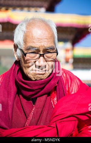 Thimphu, Bhutan.  Elderly Buddhist Monk at the  Great Buddha Dordenma Statue. - Stock Photo