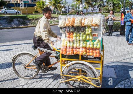 Cancun Mexico Yucatán Peninsula Quintana Roo Avenida Tulum Hispanic man woman produce fruit vendor tricycle business - Stock Photo