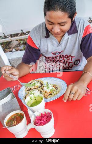Cancun Mexico Yucatán Peninsula Quintana Roo Hispanic man food cafe restaurant plate salsa condiment traditional - Stock Photo