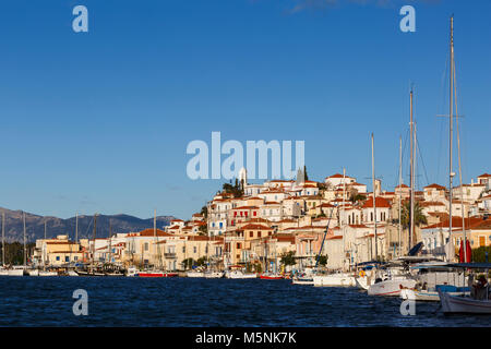View of the Chora village of Poros island over the sea, Greece. - Stock Photo