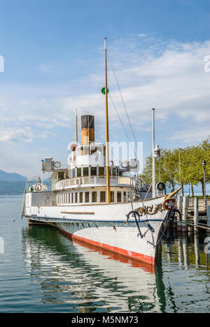 Moored Paddle Wheel Steamer in Lausanne at the Lake Geneva in Switzerland. - Stock Photo