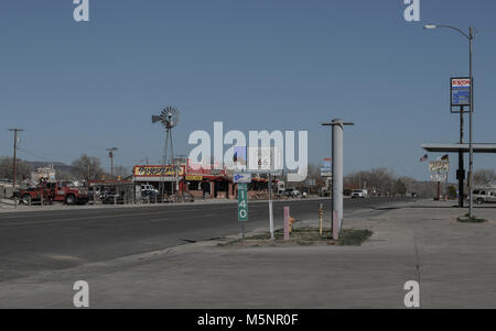 General store with the american flag swaying in the wind in the small town of Seligman in Arizona along historic - Stock Photo