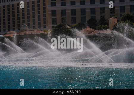 Water fountains in front of the world famous Bellagio hotel on a bright sunny day in Las Vegas, Nevada, USA, April - Stock Photo