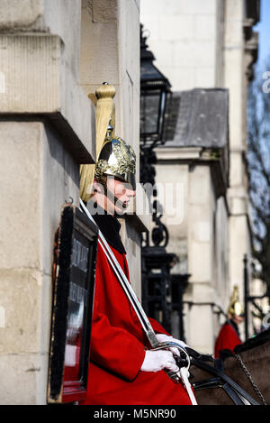 Mounted guard soldier in ceremonial winter dress guarding Horse Guards. Life Guards Household Cavalry. Whitehall, - Stock Photo