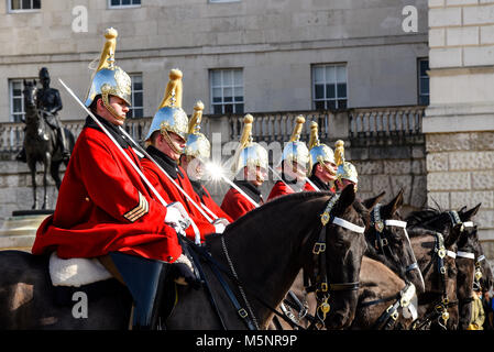 Changing of the guard, Horse Guards Parade, London. Life Guards Household Cavalry mounted soldiers in ceremonial - Stock Photo